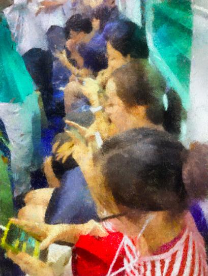 서울의 지하철 내부 모습. 좌석 한칸에 앉은 승객 전원이 스마트폰을 보고 있는 광경이 드물지 않다.