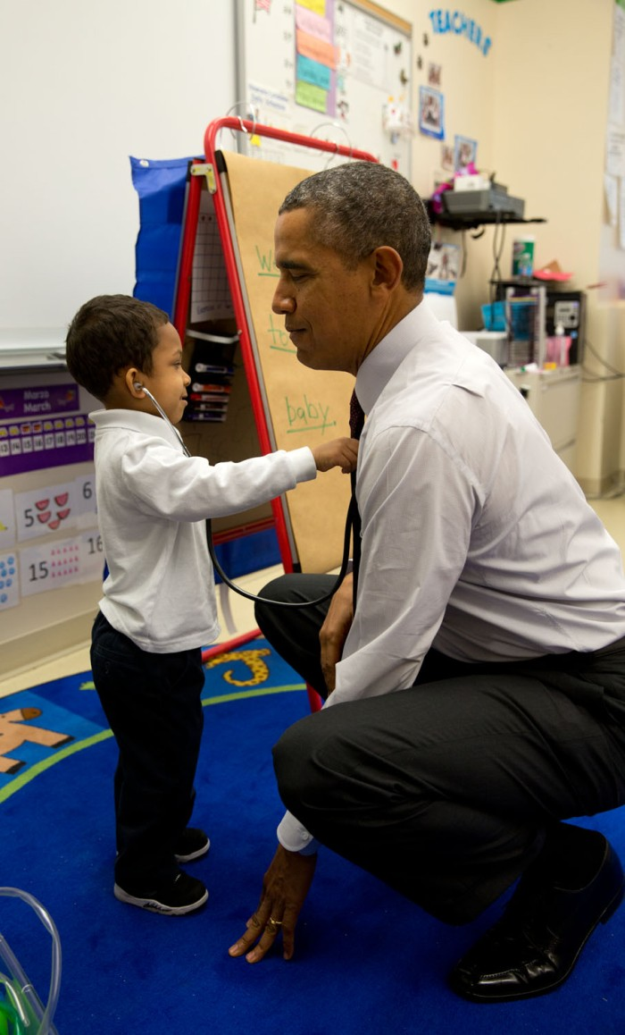 """The President was visiting a classroom at Powell Elementary School in Washington, D.C. A young boy was using a stethoscope during the class, and as the President was about to leave the room, the President asked him to check his heartbeat."""